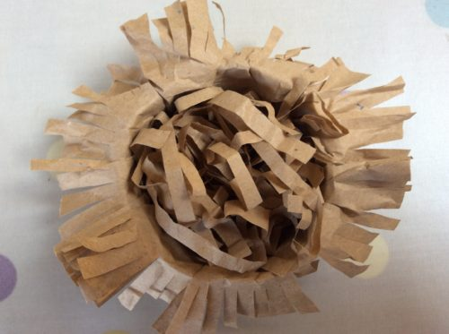 Craft Tutorial: Pom Pom Bird in a brown paper nest